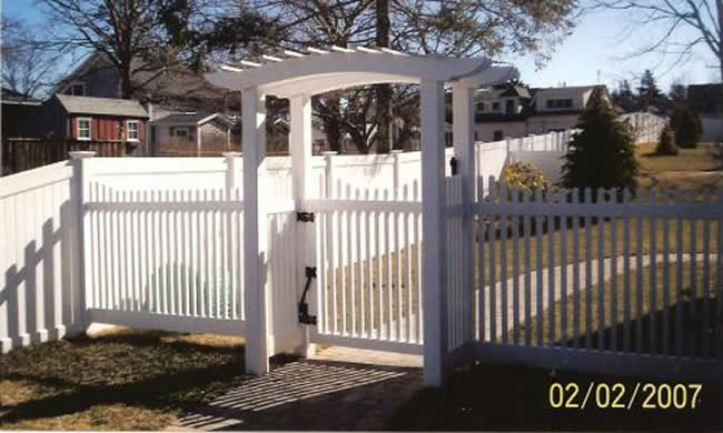 Pergola Curved Top Stepped Picket with Vinyl Board Fence in back -Pergola 2