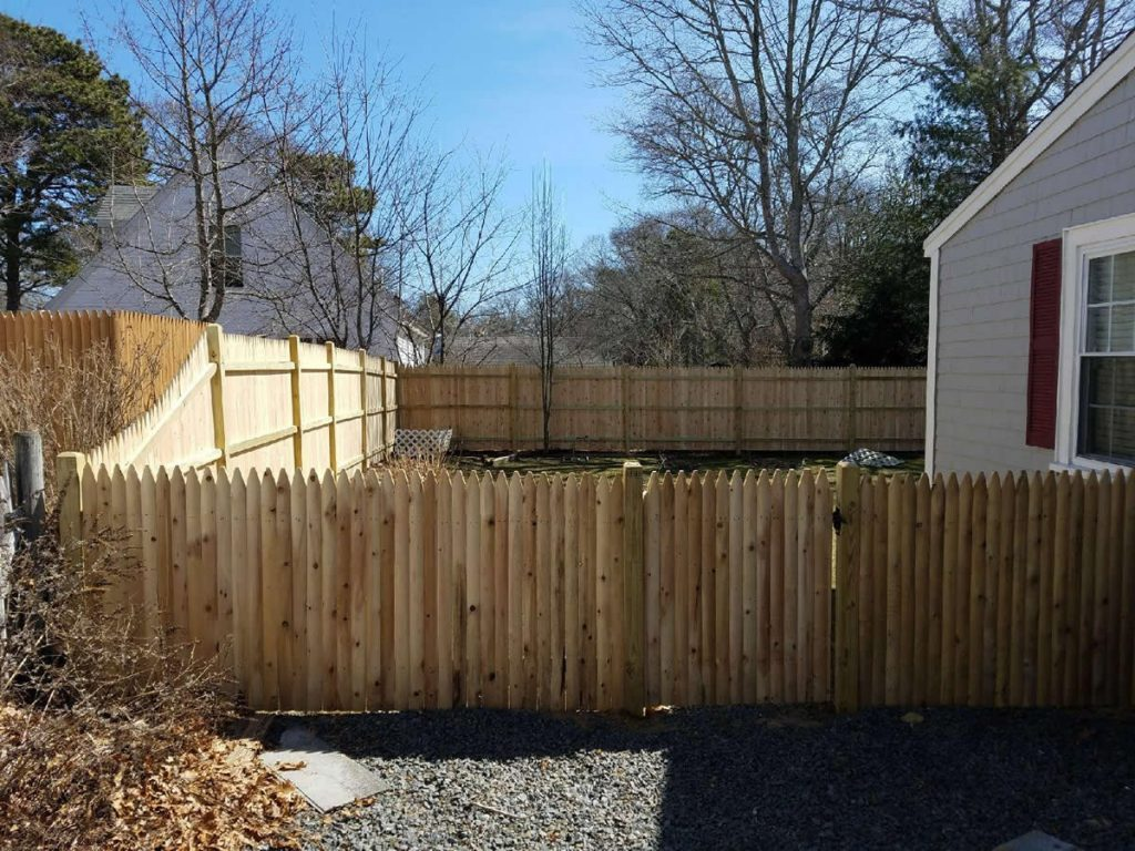 4 foot Stockade in front with taper to 6 foot surrounding back yard - Privacy 23