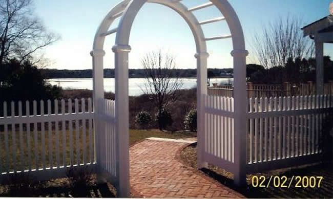 Vinyl Arbor with Vinyl Picket Fence overlooking the water -Arbor 5